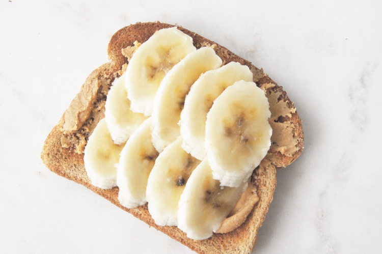 Healthy snack whole foods peanut butter and banana on whole wheat toast
